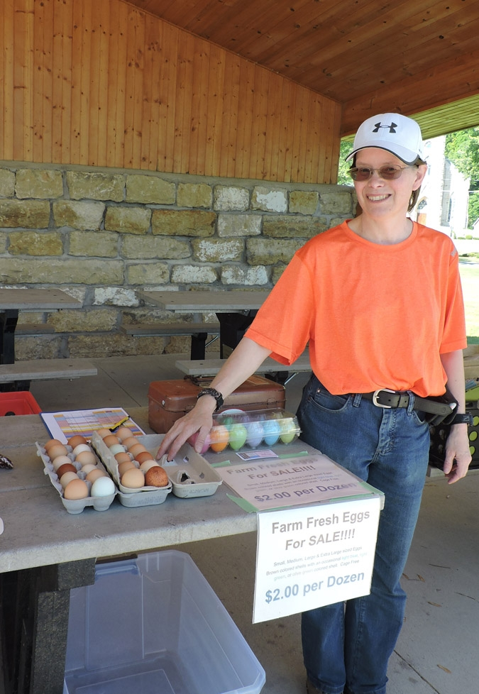 Dawn Amundson has decided to stay with the city-supported Farmers' Market that moved this spring to Founders Park, Elkader.