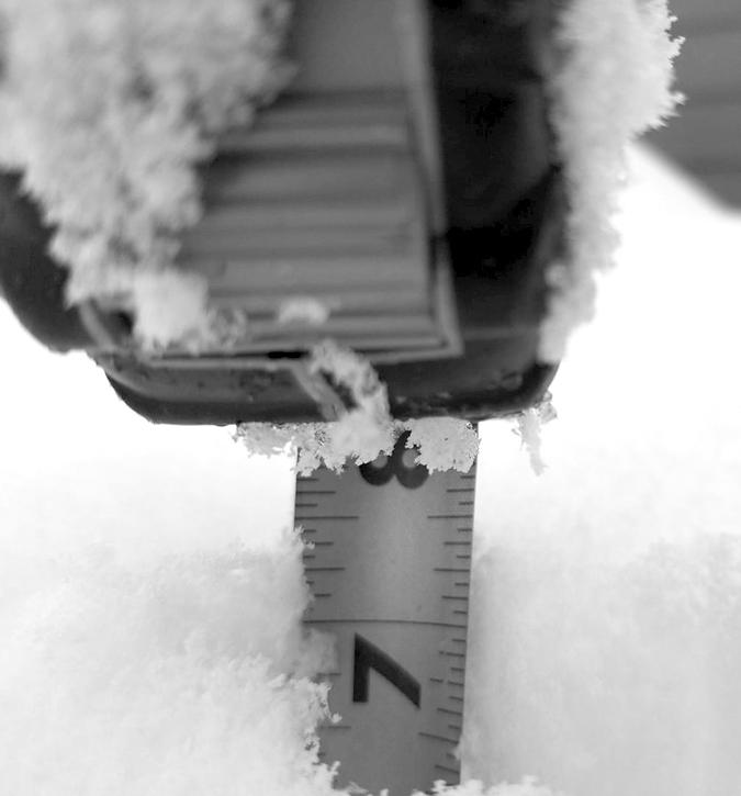 Kelly Tyer, measuring snow