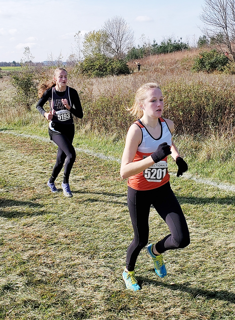 As Prairie du Chien's Meg Katzung prepared for her fourth sectional cross country race, the temperature was 36 degrees, light wind, and the sun was peeking through the clouds. As the race started, Meg was in a good spot at the 1-mile mark as she sat in sixth place right behind one of...