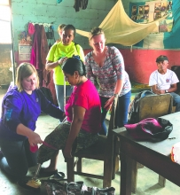 Jackie Bormann, an NIT physical therapist based in Elkader, works with a Guatemalan woman whose prosthetic leg doesn't fit. Bormann spent a week in the country on a medical misson.