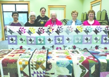 Several members of a quilting group were on hand recently to talk about their unique projects. They are, left to right: Ellen Clinton, Debby Fischer, Jillian Miller, Sandy Phillips, Kris Sass and Donna Baumler.